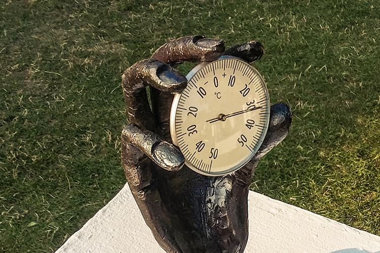 Forged sculpture - a hand holding the clock - competition entry - Hersztyn